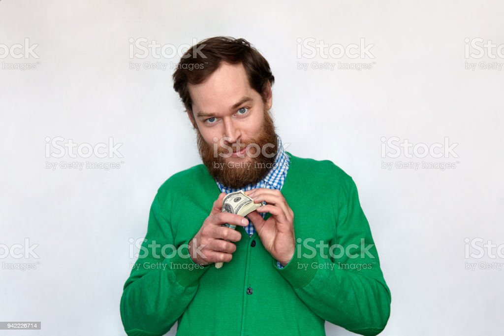 Greedy bearded man counting money stock photo