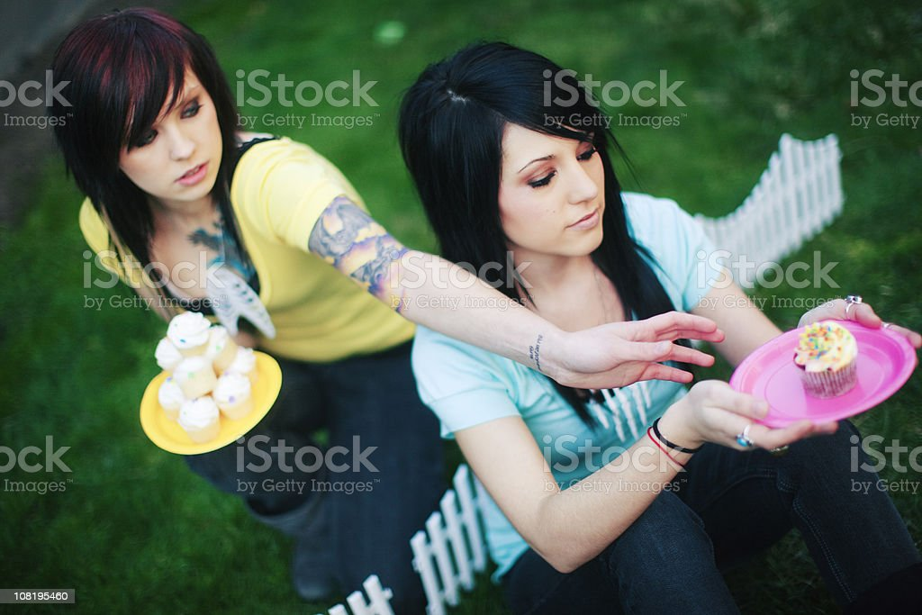Greedy Girl Reaching for a Single Cupcake royalty-free stock photo