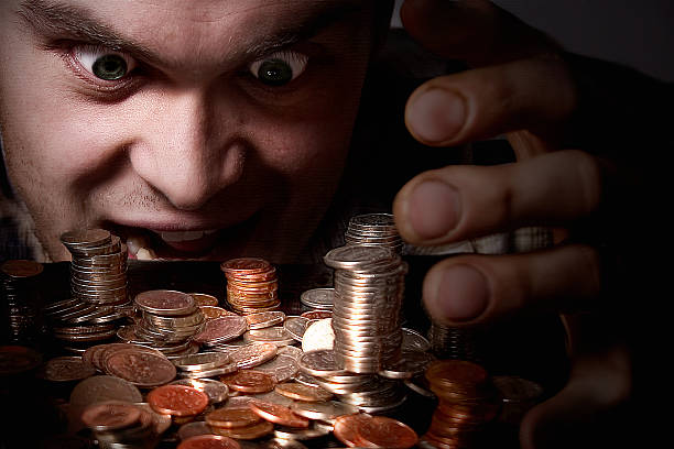 Greedy  greed stock pictures, royalty-free photos & images