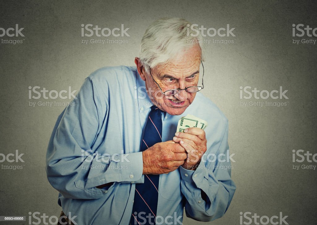 greedy senior executive, CEO, boss, old corporate employee, mature man, holding dollar banknotes stock photo