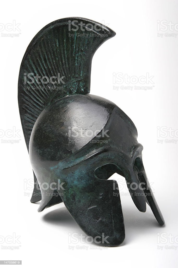 Greek ancient helmet close up isolated on white background stock photo
