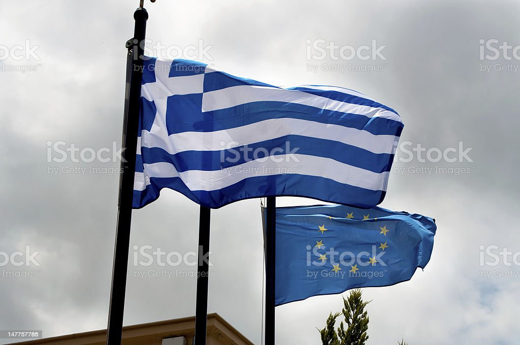 Greek and EU flags stock photo