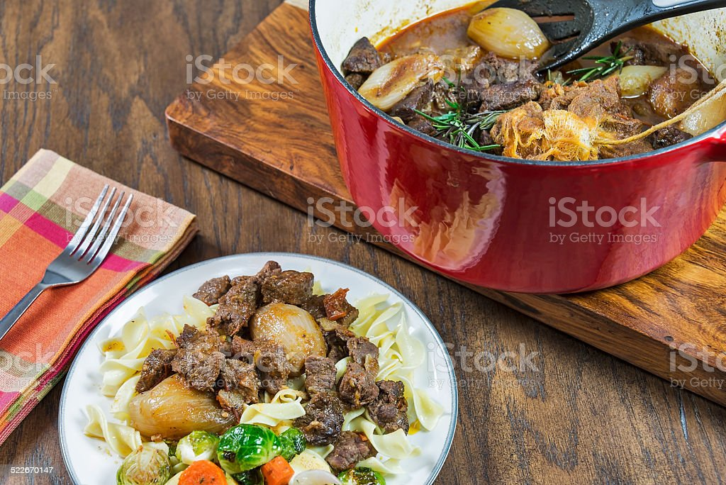 Greek beef stifado with shallots and roasted vegetables stock photo