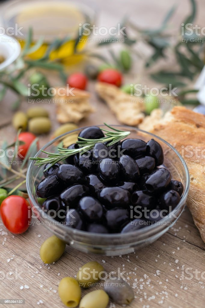 Greek black olives in the bowl served for snack royalty-free stock photo