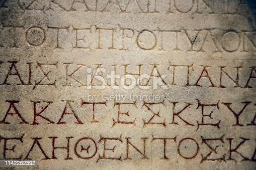 Greek alphabet carved in stone, close-up perfect for backgrounds