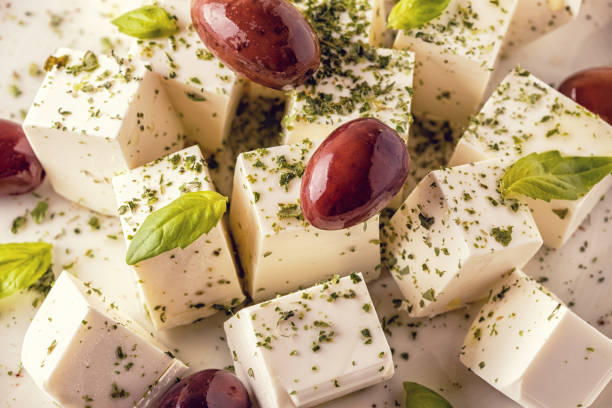 Greek cheese feta with oregano and olives Greek cheese feta with oregano and olives, selective focus. feta cheese stock pictures, royalty-free photos & images