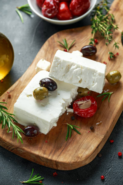 Greek cheese feta with thyme, rosemary, olives and stuffed red bell peppers Greek cheese feta with thyme, rosemary, olives and stuffed red bell peppers. feta cheese stock pictures, royalty-free photos & images