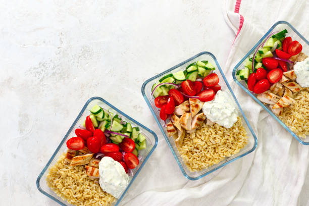 Greek chicken with tzatziki prepared and ready to eat in a take away  lunch boxes stock photo