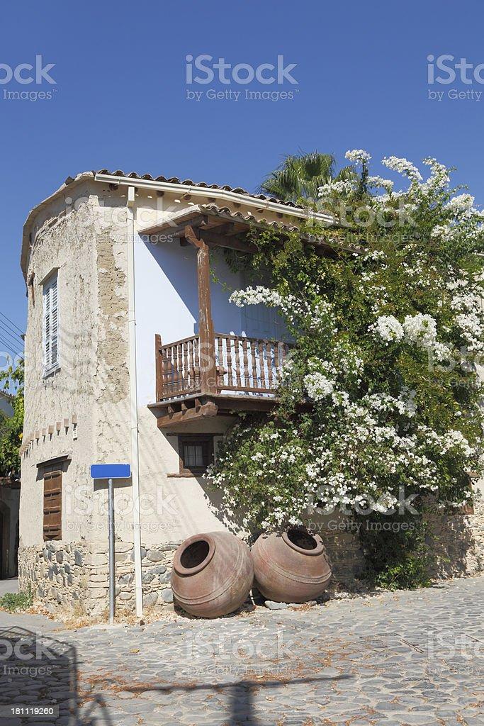 greek clay pottery cobblestone  village street with Cyprus balcony royalty-free stock photo