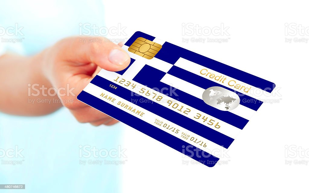 greek credit card holded by hand isolated over white stock photo