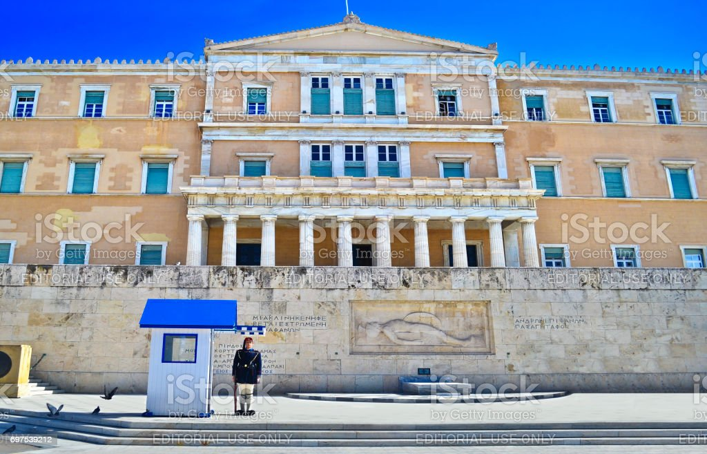greek evzones - greek tsolias - guarding the presidential mansion in front of the tomb of the unknown soldier stock photo