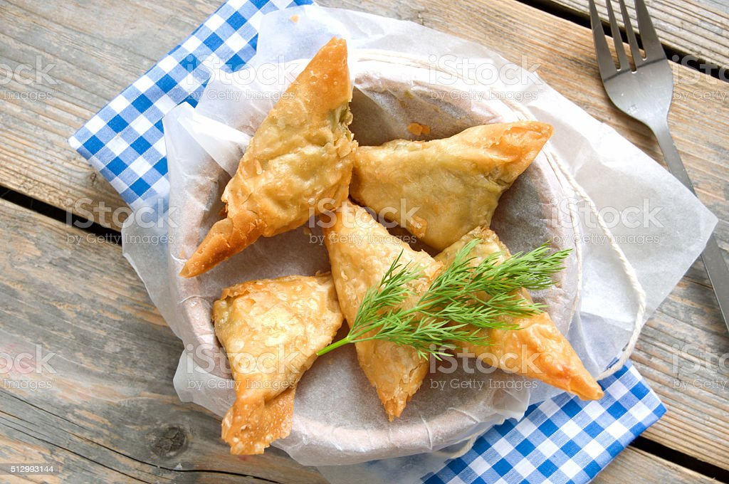 Greek feta and spinach filo pastry triangles stock photo