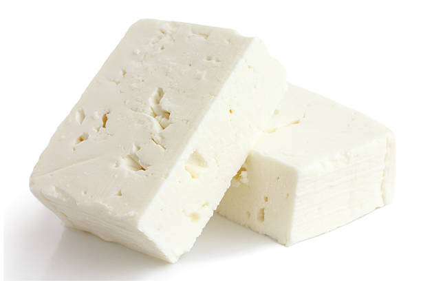 Greek feta cheese block isolated on white. Greek feta cheese block isolated on white. feta cheese stock pictures, royalty-free photos & images