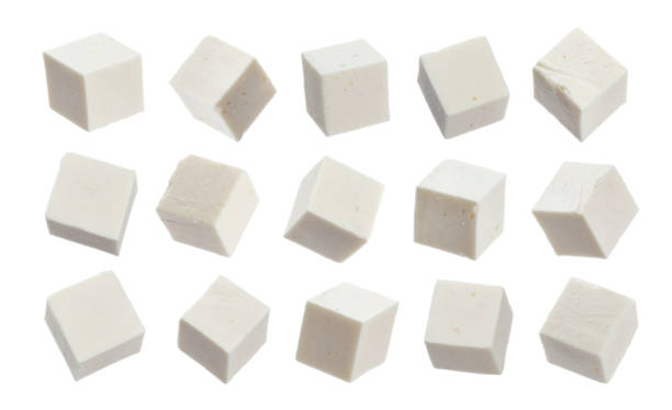 Greek feta cubes. Diced soft cheese isolated on white background Greek feta cubes. Diced soft cheese isolated on white background with clipping path feta cheese stock pictures, royalty-free photos & images
