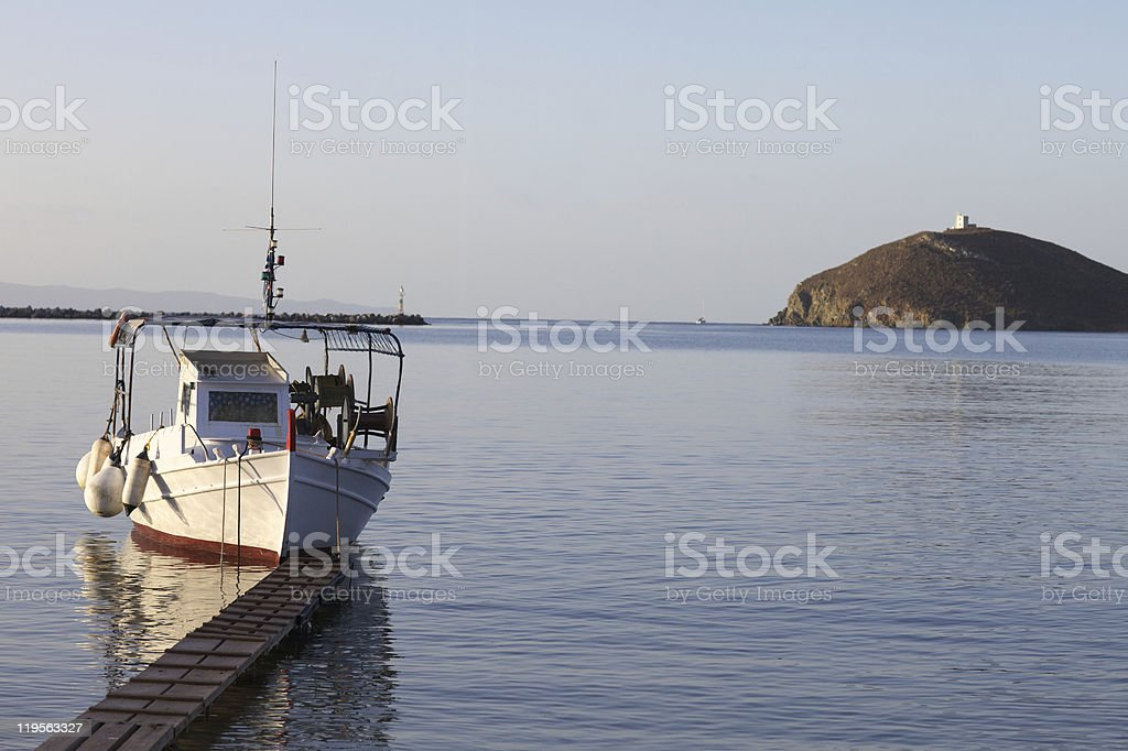 Greek fishing boat moored at the pontoon royalty-free stock photo