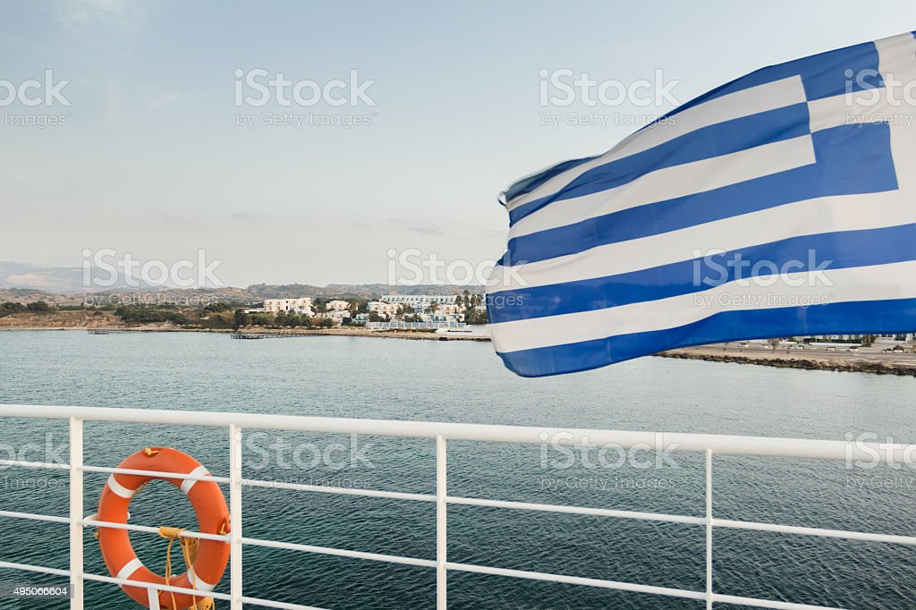 Greek flag and safety rail at Kos island background stock photo