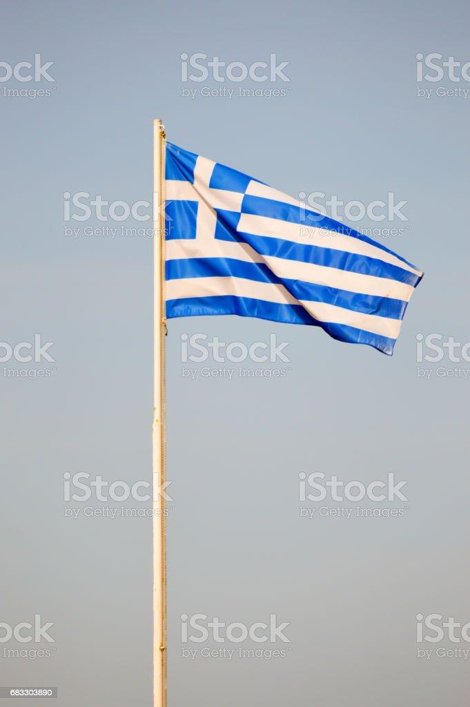 Greek flag floating on a white mat zbiór zdjęć royalty-free