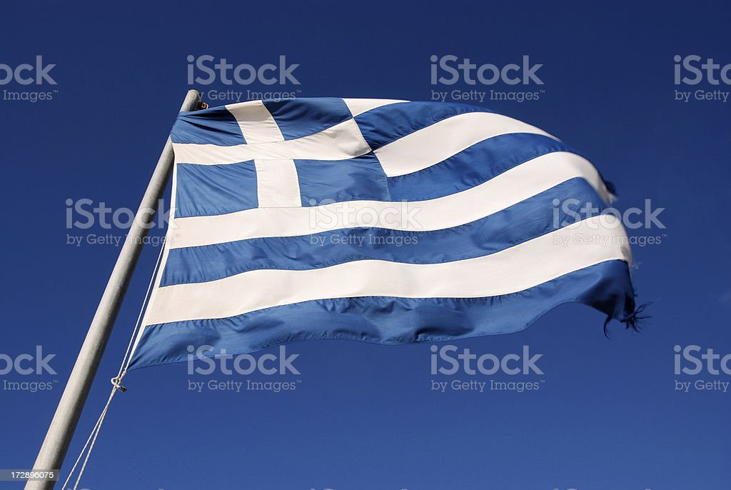 Greek flag in the wind against blue sky stock photo