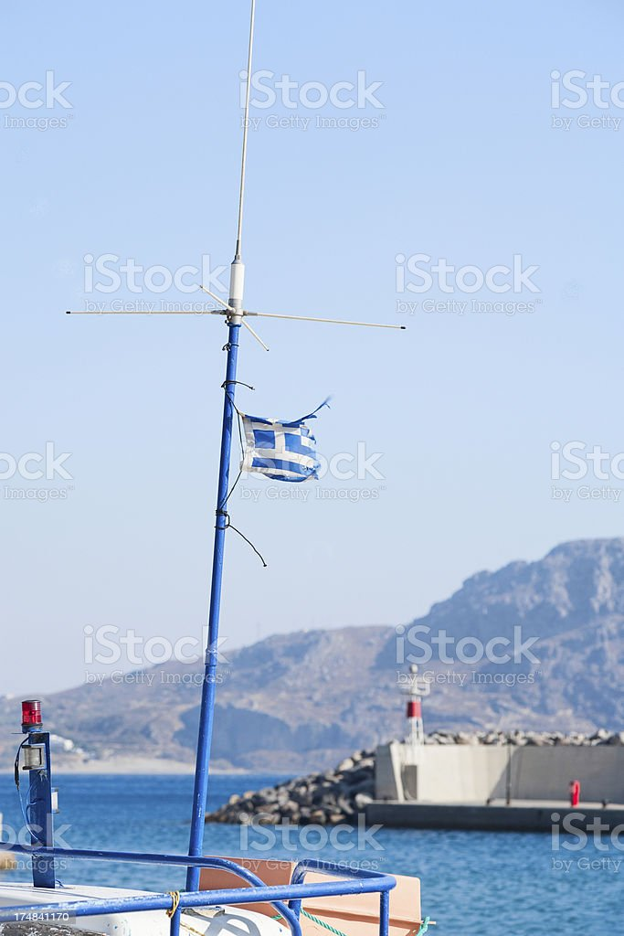 Greek flag on a small fishing boat royalty-free stock photo