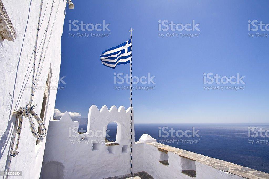 Greek flag waving in the sky stock photo