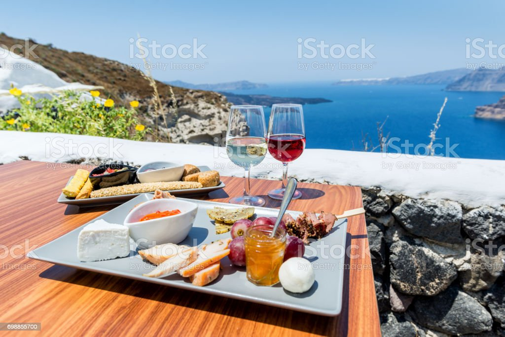 Greek food & wine with view on volcano stock photo