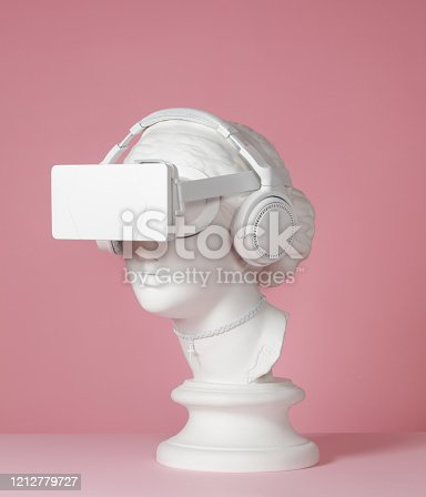 Plaster head model (mass produced replica of Head of Aphrodite of Knidos) with headphones and virtual reality headset