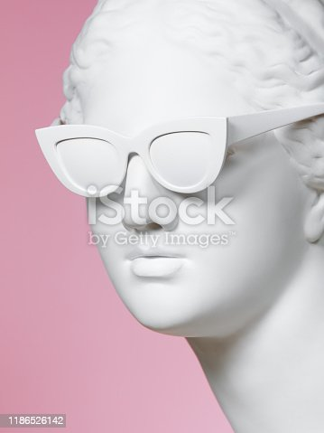 Plaster head model (mass produced replica of Head of Aphrodite of Knidos) wearing white sunglasses