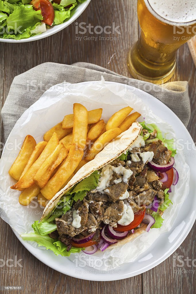 Greek Gyros with Fries and Salad stock photo
