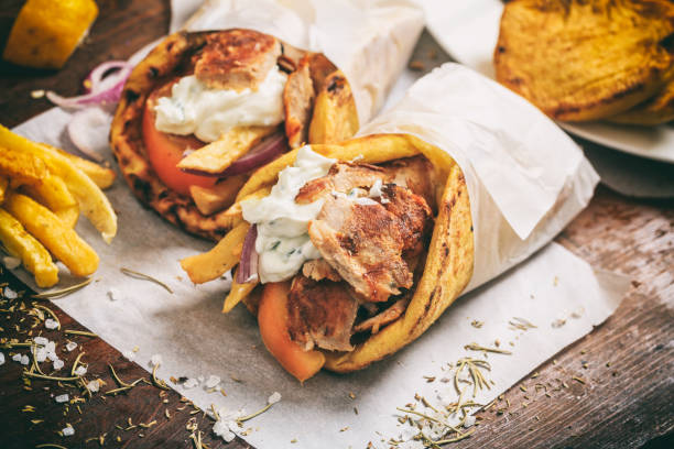 greek gyros wraped in a pita bread on a wooden background - wrapping paper stock photos and pictures