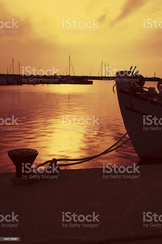 Greek harbour at sunset royalty-free stock photo