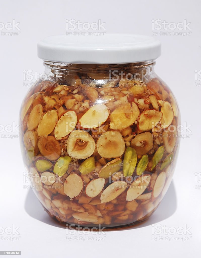 Greek Honey and Nuts Jar in Natural Light royalty-free stock photo