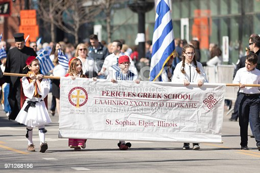 Chicago, Illinois, USA - April 29, 2018  Members of the Pericles Greek School wearing traditional clothing marching at the Greek Independence  Day Parade