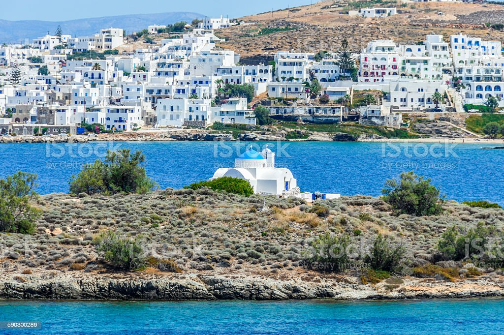 Greek Islands - Deep blue water and tiny Orthodox churches royaltyfri bildbanksbilder