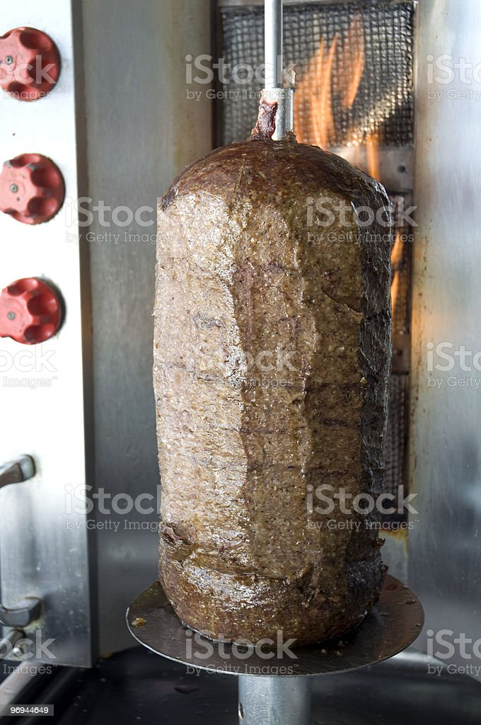Greek Lamb Gyro Meat Cooking With Flames royalty-free stock photo