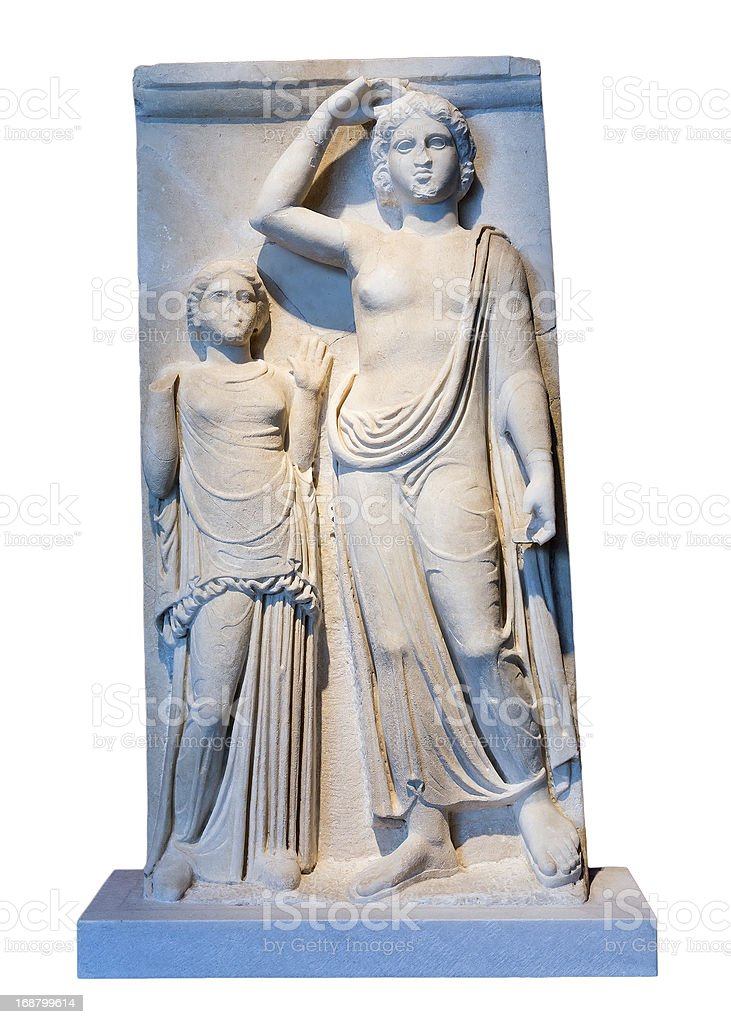 Greek marble votive stele shows Apollo and the dedicator. royalty-free stock photo