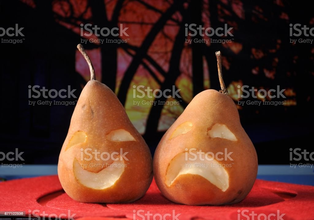 Carved pears- comedy, tragedy masks.