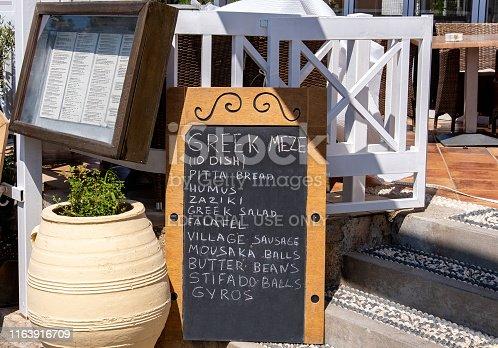 Rhodes, Greece - June 21st, 2019 :  Greek restaurant Meze menu board.  A Greek Meze is the main backbone of any quality Greek restaurant.  A meze offers the diner a small sample of the most popular items on any Greek menu.