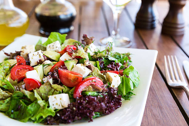 Greek Mediterranean salad Greek Mediterranean salad with feta cheese, tomatoes and peppers. Mediterranean salad. Mediterranean cuisine. Greek cuisine. feta cheese stock pictures, royalty-free photos & images