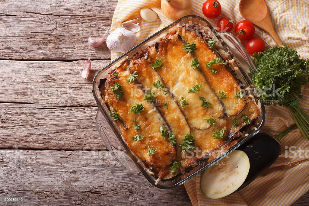 Greek moussaka in baking dish with the ingredients. horizontal stock photo
