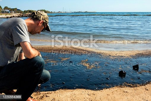 Athens, Greece, September 14 2017: Greek oil spill spreads to Athens Riviera following the sinking of an oil tanker in Saronic Gulf.