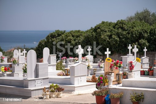 Detail of cemetery on the Greek Island of Chios at midday in summer. Shallow depth of field. Blurred background. The image was captured with a prime lens and a full frame DSLR camera at low ISO resulting in large clean files.