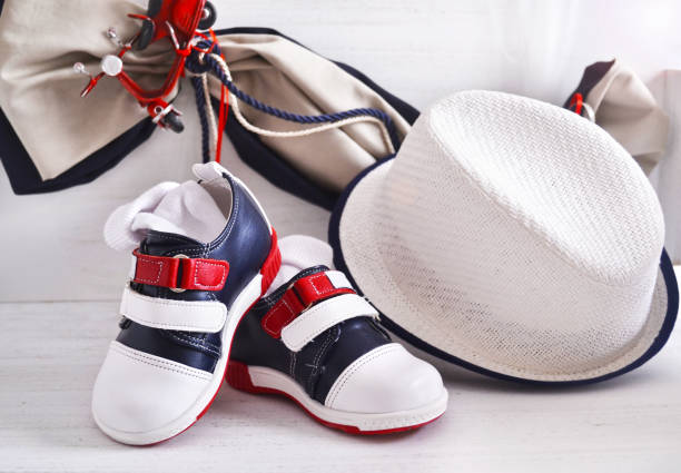 greek Orthodox christening - baby boy clothes, shoes and hat stock photo