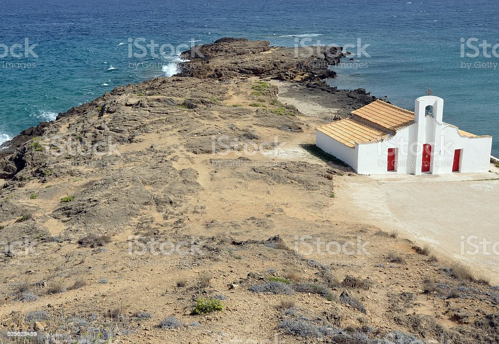Greek Orthodox Church sitting up on the cliff overlooking the bay stock photo