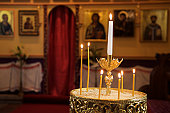 Place of worship, greek orthodox, candle holder and icons in background