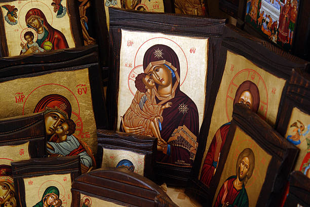 Greek Orthodox Religious Icons Greek Orthodox religious Icons displayed at a store for sale in Tinos, Greece. religious symbol stock pictures, royalty-free photos & images
