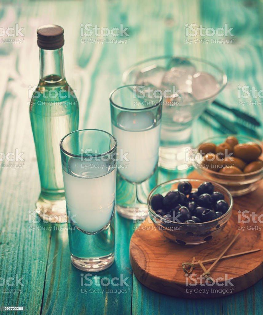Greek Ouzo and Olives stock photo