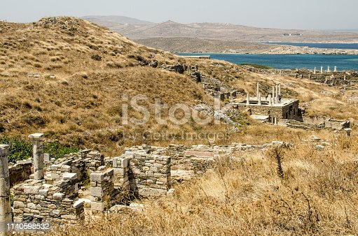 ruins of classical greek architecture carved in marble on the island of delos near mykonos in greece