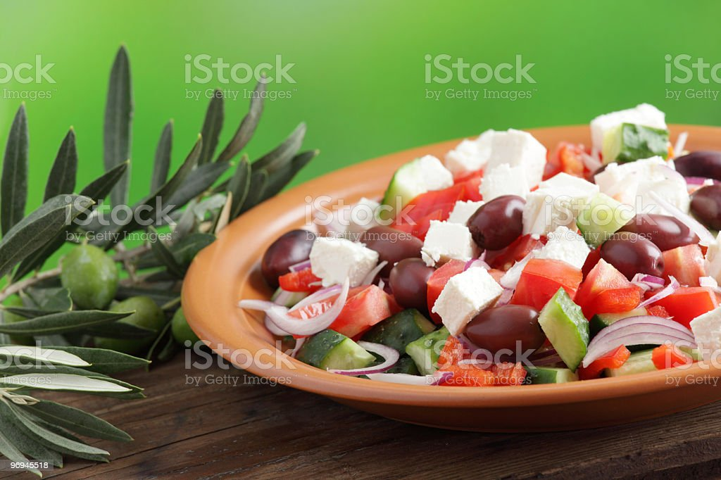 Greek salad and olive branch royalty-free stock photo