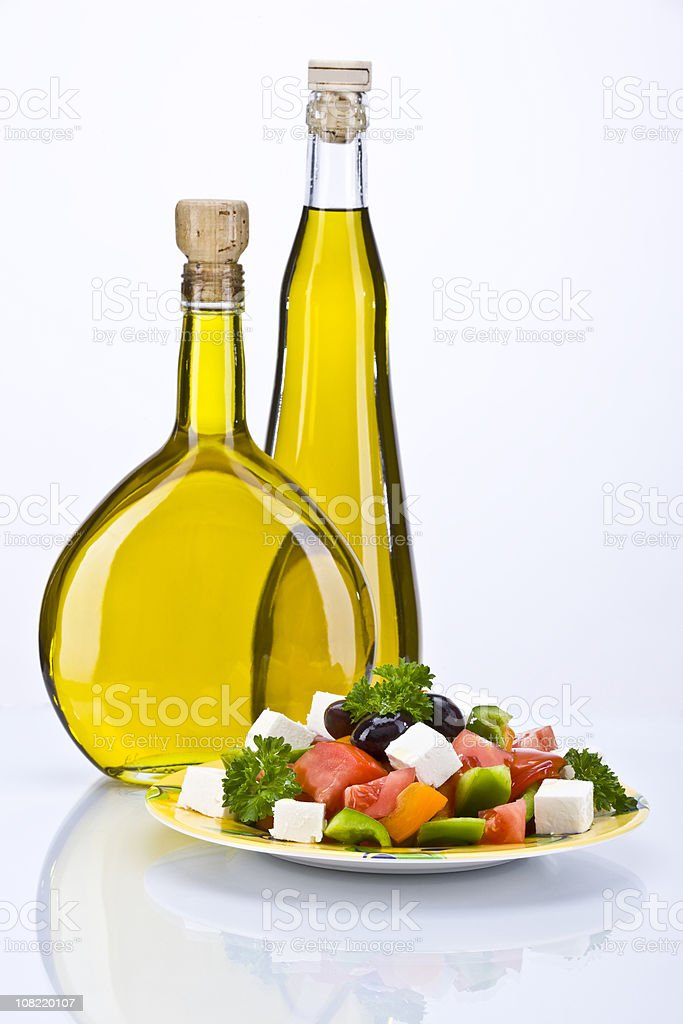 Greek Salad and Olive Oil in Two Bottles royalty-free stock photo