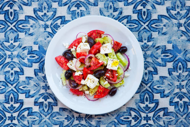 Greek salad. Fresh vegetables, feta cheese and black olives. Top view. stock photo